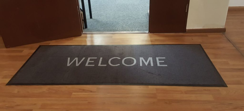 Logo mat Welcome